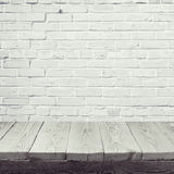 Empty wooden table over white brick wall background Stock Photo