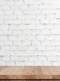 Empty wooden table over white brick wall background. Template royalty free stock photos