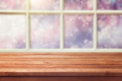 Empty wooden table over window with winter background stock photos