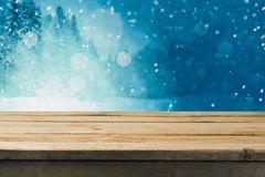 Empty wooden table over winter forest background. Mock up table template for product montage Royalty Free Stock Photo
