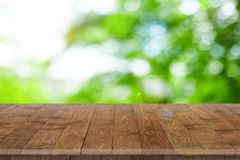 Empty wooden table perspective for product. Placement or montage with focus to table. Wooden board surface Royalty Free Stock Photography