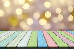 Empty wooden table or plank with bokeh of light from xmas tree on background. royalty free stock photos