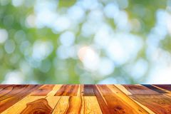 Empty wooden table or plank with bokeh of tree light in the garden or forest on background. Empty wooden table or plank with bokeh of tree light in the garden stock photography