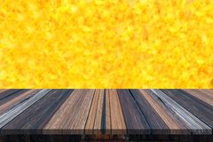 Empty wooden table or plank with yellow color like a surface of sun or fire on background for product display. Copy space available stock photo