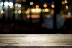 Empty wooden table platform and bokeh at night.  stock image