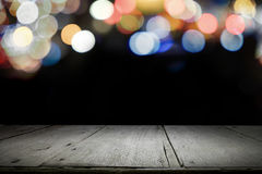 Empty wooden table platform and bokeh at night. Royalty Free Stock Images