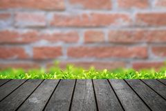 Empty wooden table platform with brick wall background stock photos