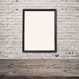 Empty wooden table with poster mock up template over brick wall Royalty Free Stock Images