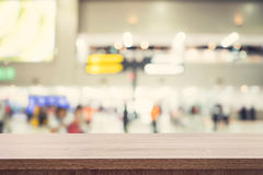 Empty wooden table for product placement or montage and blurred. Terminal department at airport background Royalty Free Stock Images