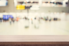 Empty wooden table for product placement or montage and blurred. Terminal department at airport background Royalty Free Stock Photos
