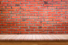 Empty wooden table with red brick wall background. Royalty Free Stock Photography