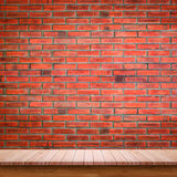 Empty wooden table with red brick wall background. Royalty Free Stock Images