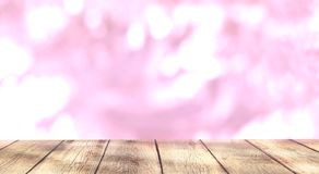 Empty wooden table on shiny pink bokeh background. stock photos