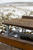 Empty wooden table with snow bokeh for a catering or food background stock photo