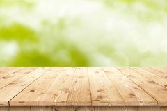 Empty wooden table in a sun for product placement or montage Royalty Free Stock Photo