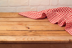 Empty wooden table with tablecloth. Kitchen background. Empty wooden table with checked red tablecloth. Kitchen background Royalty Free Stock Photos