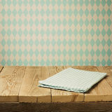 Empty wooden table with tablecloth over bavarian pattern wallpaper. Oktoberfest beer festival concept Stock Photography