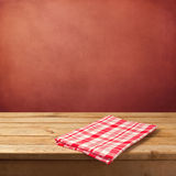Empty wooden table with tablecloth for product montage display Royalty Free Stock Photo