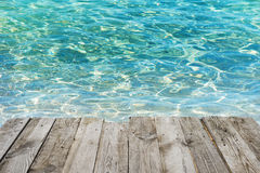 Empty wooden table to tropical blue water background Royalty Free Stock Image