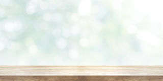 Empty wooden table top with blurred abstract background. Panoram Stock Photography