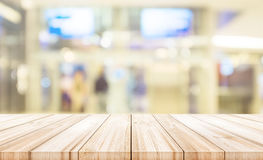 Empty wooden table top with blurred modern shopping mall backgro Royalty Free Stock Image