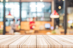 Empty wooden table top with blurred restaurant interior backgrou. Nd. can be used product display Stock Image
