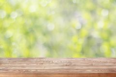 Empty wooden table top on blurred spring background with bokeh. Stock Images