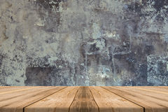 Empty Wooden Table top at concrete wall - can be used for displa Royalty Free Stock Images