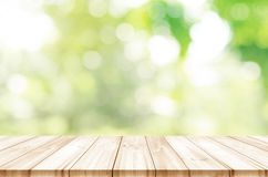 Empty wooden table top front of morning light with blurred natur. Al abstract background. can be used product display Royalty Free Stock Images