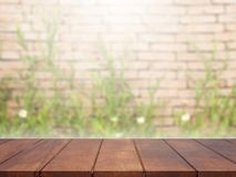Empty wooden table top on green blurred background royalty free stock photos