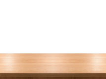 Empty wooden table top isolated on white background, used for display or montage your products Royalty Free Stock Images