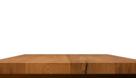 Empty wooden table top isolated on white background, used for display or montage your products Royalty Free Stock Photo