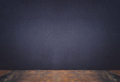 Empty wooden table top Matt Black wall background with Copy Spac Royalty Free Stock Photography