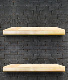 Empty Wooden Table top and shelf at black bricks wall,Template m Stock Photo