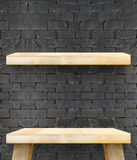 Empty Wooden Table top and shelf at black bricks wall,Template m Stock Photos