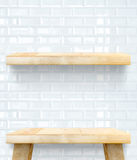 Empty Wooden Table top and shelf at white tile ceramic wall,Temp Stock Photo