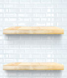 Empty Wooden Table top and shelf at white tile ceramic wall,Temp Royalty Free Stock Photo
