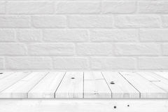 Empty wooden table with white brick wall background. For display or montage your products royalty free stock photos
