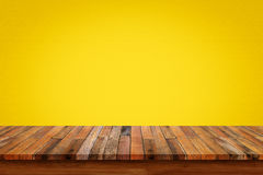 Empty wooden table with yellow gradient wall background. royalty free stock images