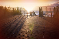 Empty wooden terrace by the sea at sunset Royalty Free Stock Photography