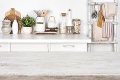 Empty wooden texture table with blurred image of kitchen interior royalty free stock photography