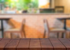 Empty wooden top table and blurred coffee shop background royalty free stock photography