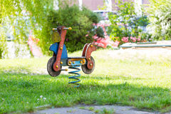 Empty wooden traditional swing on playground. Horizontal crop in sunny day Royalty Free Stock Photography