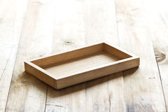 Empty wooden tray on plank wooden background Stock Photography