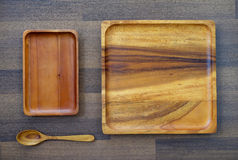 Empty wooden tray and spoon on table, food background Stock Photo