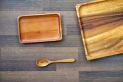 Empty wooden tray and spoon on table, food background Royalty Free Stock Images