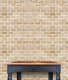 Empty wooden vintage table on brick tiles wall,Mock up for displ Royalty Free Stock Photos