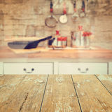 Empty wooden vintage table over kitchen blurred background Royalty Free Stock Photos
