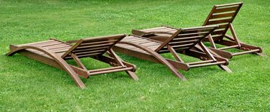 Empty Wooden Weathered Lounger On The Lawn At The Evening Stock Photos