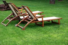 Empty Wooden Weathered Lounger On The Lawn At The Evening Stock Photography
